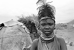 A Turkana girl,  Lokitaung nr the Ilami triangle in the  Northern part of the Kenya bordering Sudan and Ethiopia.<br /> The headress denotes her unmarried status.
