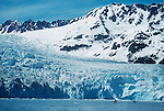 Alaska, Aialik glacier, Kenai Fjords National Park, sea kayakers approach tidewater glacier, Kenai Fjord, Alaska.