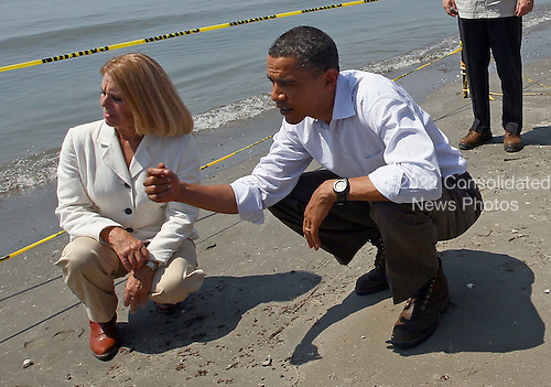 United States President Barack Obama (R) tours the beach at Port Fourchon with Parish President Charlotte Randolph, Friday, May 28, 2010 in Port Fourchon, Louisiana. The oil spill resulting from the Deepwater Horizon disaster now officially ranks as the worst in U.S. history. .Credit: Win McNamee - Pool via CNP