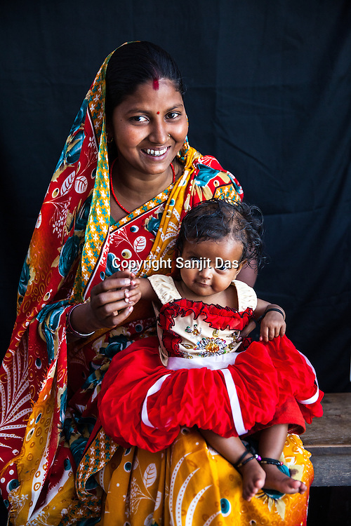 21 year old Asha Devi poses for a portrait with her 11 month daughter, Sita Mandal at the government health centre in Hanuman Nagar in Saptari, Nepal.