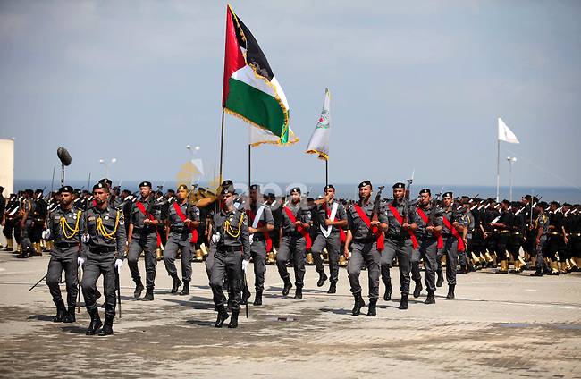 Members of the Palestinian Hamas security forces take part in a graduation ceremony in Gaza City on June 16, 2015. Photo by Ashraf Amra