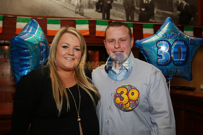 Gareth Floyd  celebrating his 30th in McHughs with partner Georgina Gardnern and Family.Picture: Fran Caffrey/www.newsfile.ie.