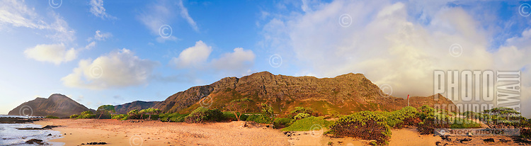 A dramatic sunrise lights up a panorama of the beach and cliffs at Makapu'u, southeastern O'ahu.