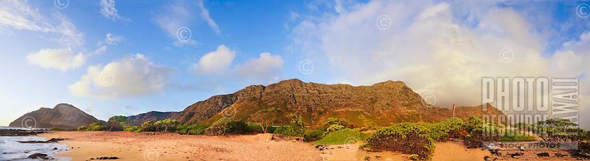 A dramatic sunrise lights up a panorama of the beach and cliffs at Makapu'u, southeastern O'ahu.
