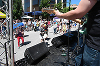 NWA Democrat-Gazette/J.T. WAMPLER Dancers move to to reggae music by the local band Irie Lions Sunday May 21, 2017 at the Seventh annual Block Street Block Party held all along Block Ave. from the square to Dickson St. Thousands of people attended with around 150 vendors, 90 bands, several beer gardens and more.
