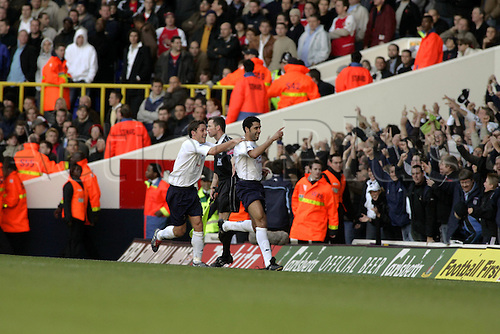 13 November 2004: Spurs Defender Noureddine Naybet celebrates with Michael Brown after opening the scoring during the Premiership match between Tottenham Hotspur and Arsenal. Arsenal won the game played at White Hart Lane 5-4. Photo: Action Plus..041113 soccer football premier league premiership player players footballer footballers celebrations celebration celebrates celebrate joy celebrating