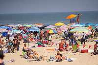 Beachgoers escape the heat at Rockaway Beach in the Queens borough of New York on Sunday, July 19, 2015.  The temperature climbed to 93 F with Monday expected to hit 92 F making them the first and second over 90 days of the year. If Tuesday hits 90 the city will have its first heat wave of the year. (© Richard B. Levine)