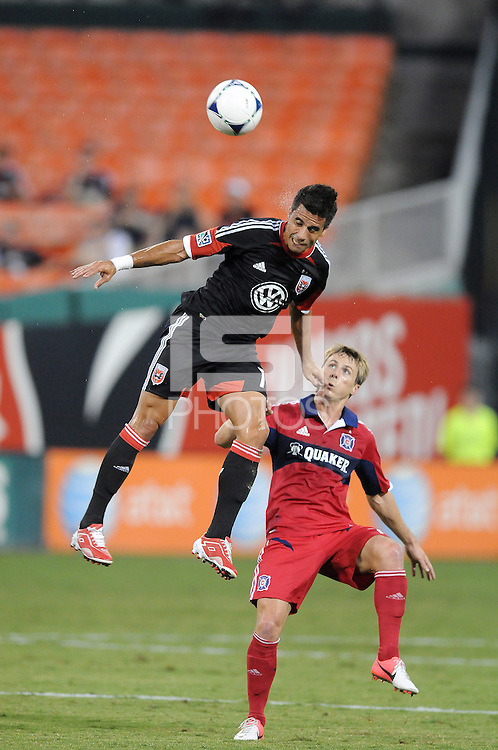 D.C. United midfielder Marcelo Saragosa (11) heads the ball against Chicago Fire forward Chris Rolfe (18) D.C. United defeated The Chicago Fire 4-2 at RFK Stadium, Wednesday August 22, 2012.