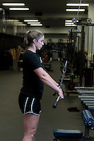 Assistant UVa strength and conditioning coach   Jenny Shultis demonstrates the straight arm lat pull exercise at the McCue Center weight room on campus at the University of Virginia in Charlottesville, VA. Photo/Andrew Shurtleff