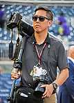 7 October 2017: Washington Nationals team photographer Paul Kim walks to his shooting position prior to the second game of the NLDS against the Chicago Cubs at Nationals Park in Washington, DC. The Nationals rallied to defeat the Cubs 6-3 and even their best of five Postseason series at one game apiece. Mandatory Credit: Ed Wolfstein Photo *** RAW (NEF) Image File Available ***
