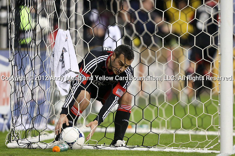 18 November 2012: DC's Hamdi Salihi (ALB) retrieves the ball from the net after a DC goal. DC United played the Houston Dynamo at RFK Stadium in Washington, DC in the second leg of their 2012 MLS Cup Playoffs Eastern Conference Final series. The game ended in a 1-1 tie, Houston won the series 4-2 on aggregate goals.