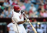 Jun. 8, 2012; Phoenix, AZ, USA; Arizona Diamondbacks outfielder Justin Upton hits a single in the first inning against the Oakland Athletics at Chase Field.  Mandatory Credit: Mark J. Rebilas-