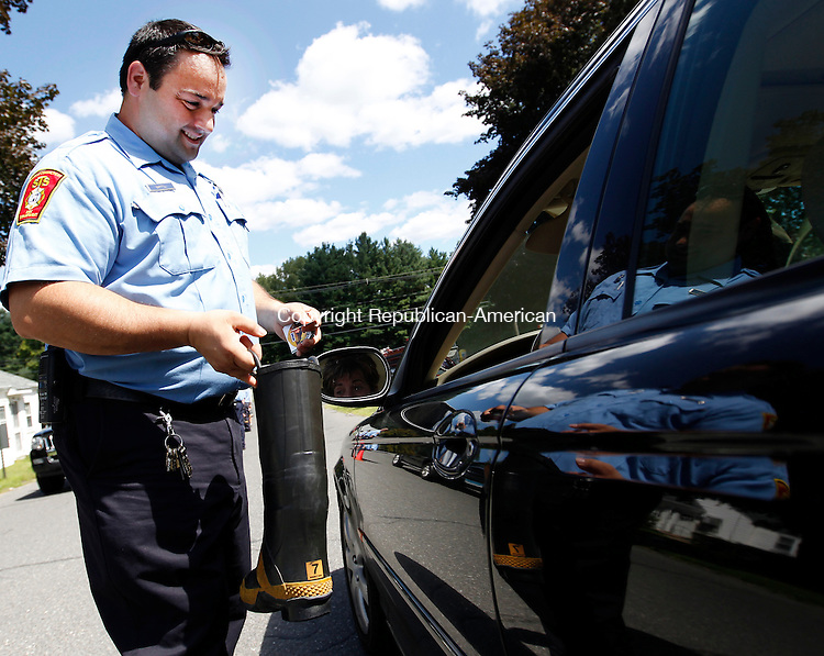 "Southbury, CT- 12, August 2011-081211CM09 STS Firefighter, Patsy Bartoli collects money for MDA (Muscular Dystrophy Association), outside the Southbury Training School Friday afternoon.  Firefighters will be out ""filling the boot"",  in the Southbury Shopping Plaza outside of K-Mart, today from 8:00am to 11:00am.    Christopher Massa Republican-American"