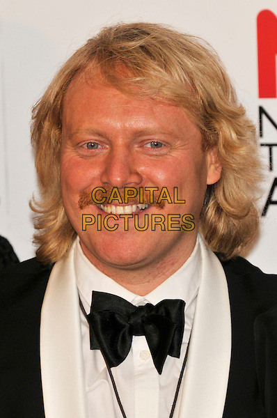 LEIGH FRANCIS .Attending the National Television Awards at O2 Arena, London, England..January 26th, 2011.NTA NTAs press room portrait headshot black bow tie white shirt scarf smiling moustache mustache facial hair avid merrion keith lemon .CAP/PL.©Phil Loftus/Capital Pictures.