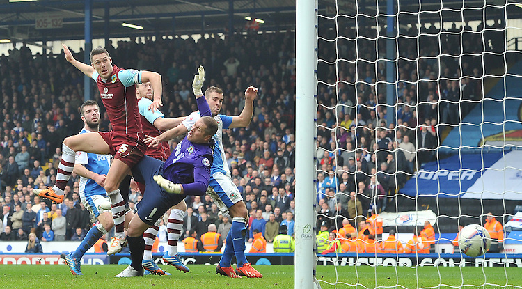 Burnley's Jason Shackell beats the keeper to score his team's first goal<br /> <br /> Photo by Dave Howarth/CameraSport<br /> <br /> Football - The Football League Sky Bet Championship - Saturday 9th March 2014 - Blackburn Rovers v Burnley - Ewood Park - Blackburn<br /> <br /> &copy; CameraSport - 43 Linden Ave. Countesthorpe. Leicester. England. LE8 5PG - Tel: +44 (0) 116 277 4147 - admin@camerasport.com - www.camerasport.com
