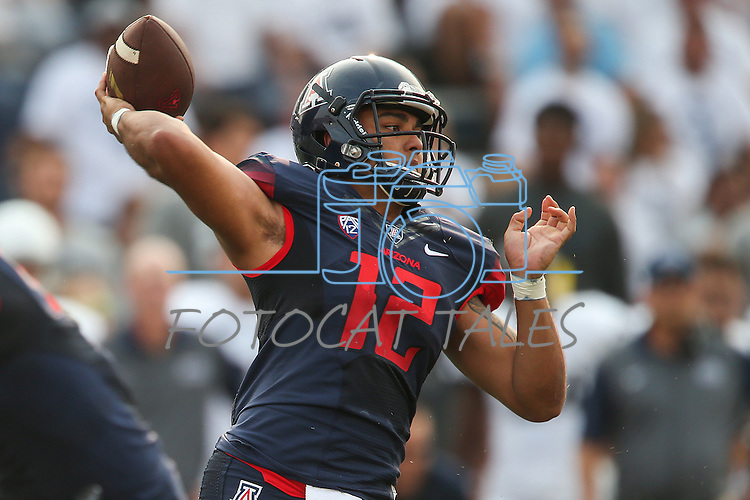 Arizona quarterback Anu Solomon (12) passes against Nevada during the first half of an NCAA college football game in Reno, Nev. on Saturday, Sept. 12, 2015. (AP Photo/Cathleen Allison)