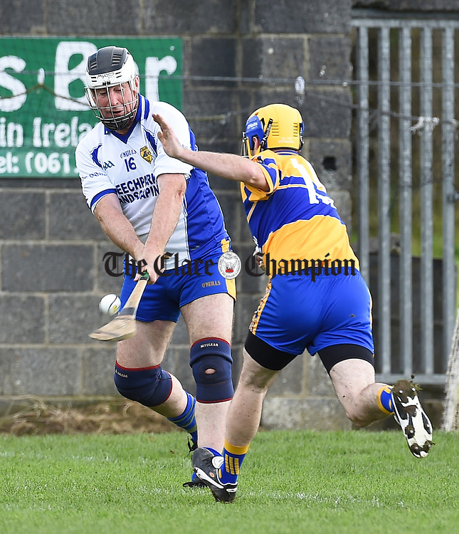 Donal Marron of The Banner in action against Martin Conlon of Sixmilebridge during their Junior C hurling final in Newmarket. Photograph by John Kelly.