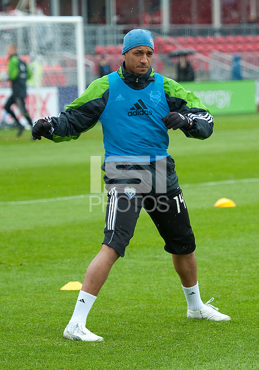 25 April 2010: Seattle Sounders defender Tyrone Marshall #14 warms up during a game between the Seattle Sounders and Toronto FC at BMO Field in Toronto..Toronto FC won 2-0....