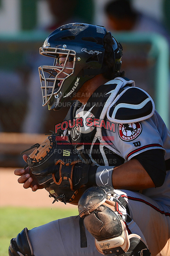 Jose Ortiz (40) of the Billings Mustangs on defense against the Ogden Raptors in Pioneer League play at Lindquist Field on August 18, 2013 in Ogden Utah.  (Stephen Smith/Four Seam Images)
