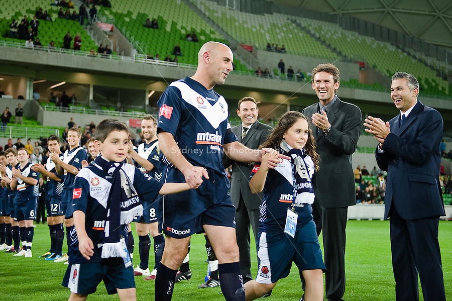 MELBOURNE, AUSTRALIA - May 14, 2010: Kevin Muscat from Melbourne Victory is cheered onto the ground by his team mates at the Kevin Muscat Testimonial match between the Melbourne Victory and Come Play XI at AAMI Park on May 14, 2010 in Melbourne, Australia. Photo Sydney Low www.syd-low.com