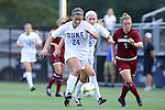 14 August 2014: Duke's Morgan Reis (24) and South Carolina's Savannah McCaskill (7). The Duke University Blue Devils hosted the University of South Carolina Gamecocks at Koskinen Stadium in Durham, NC in a 2014 NCAA Division I Women's Soccer preseason match. Duke won the exhibition 2-0.