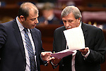Nevada Assembly Republicans Paul Anderson, left, and John Ellison work on the Assembly floor at the Legislative Building in Carson City, Nev., on Friday, Feb. 13, 2015. <br /> Photo by Cathleen Allison