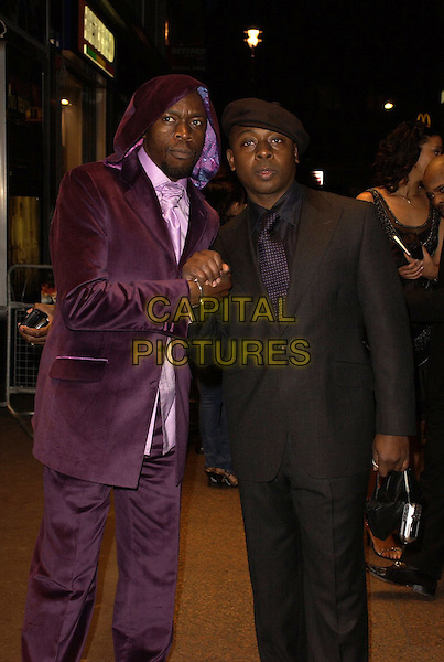 """VAS BLACKWOOD & ROBBIE GEE.""""Rollin' With The Nines"""" - UK premiere at the Odeon Leicester Square, London, UK..April 19th, 2006.Ref: CAN.half length purple black suit jacket shaking hands hat.www.capitalpictures.com.sales@capitalpictures.com.©Capital Pictures"""