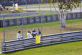 flagmen with yellow caution flag during car race at Circuit Mont-Tremblant in Quebec