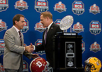 LSU Head Coach Les Miles and Alabama Head Coach Nick Saban shake hands together after group pictures with BCS National Championship Trophy during BCS National Championship Head Coaches Press Conference at Marriott Hotel at the Convention Center at New Orleans, Louisiana on January 8th, 2012.