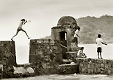 PANAMA, Portobello, children playing and fishing on an old Spanish fortress (B&W)