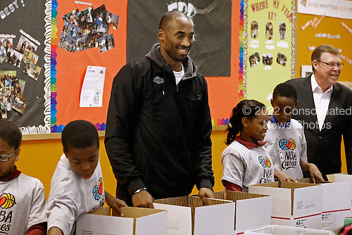 Los Angeles Lakers guard Kobe Bryant helps children volunteers fill care packages during a NBA Cares service event at the Boys and Girls Club at THEARC, December 13, 2010 in Washington, DC. Bryant and all the members of the 2010 NBA Championship Lakers team volunteered on projects at the club before being honored by the president for their victory.  .Credit: Chip Somodevilla - Pool via CNP