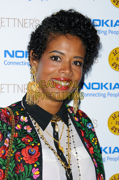 Kelis (Kelis Rogers).Jeans for Genes launch party at Kettners, London, England..September 5th, 2011.headshot portrait gold earrings necklace piercing nose bullring lipstick black embroidered jacket green red floral print jacket.CAP/CJ.©Chris Joseph/Capital Pictures.