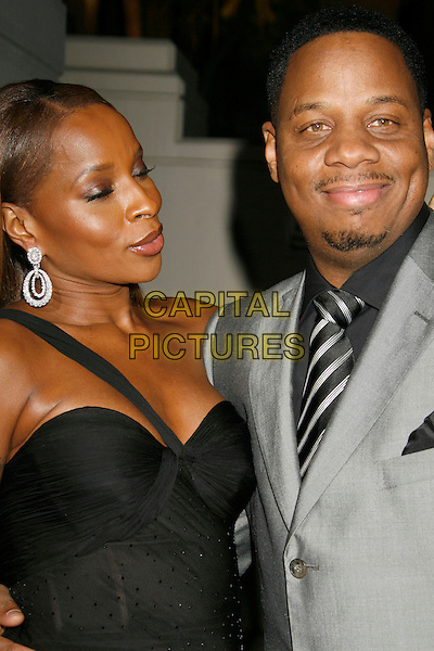 MARY J. BLIGE & KENDU ISAACS.Gianni And Donatella Versace Receive Rodeo Drive Walk Of Style Award held at the Beverly Hills City Hall, Beverly Hills, California, USA. .half length black one shoulder strap grey gray suit jacket husband wife diamond earrings.CAP/ADM/RE.©Russ Elliot/AdMedia/Capital Pictures