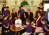 United States President Bill Clinton and first lady Hillary Rodham Clinton participate in a menorah lighting to celebrate the first night of the Jewish festival of Hanukkah at the White House in Washington, D.C. on December 3, 1999.  A class of 20 fourth grade students from Gesher Day School of Northern Virginia in Fairfax, VA join in the festivities.  The menorah that was used was made as a tribute to the Breed Street Shul in Los Angeles, CA.  The menorah was commissioned by the Jewish Historical Society of Southern California to commemorate the First Lady's visit to the Synagogue in 1998.  The Breed Street Shul has been designated a Save America's Treasures project..Credit: Ron Sachs / CNP
