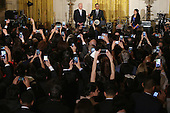 United States President Barack Obama (C) delivers remarks during a reception to mark the Cinco de Mayo holiday with Vice President Joe Biden and Yanely Gonzalez (R) in the East Room at the White House May 5, 2016 in Washington, DC. Gonzalez's parents are undocumented immigrants from Mexico and she is a U.S. citizen who will vote in her first presidential election this year. The holiday commemorates the Mexican Army's unlikely victory over French forces at the Battle of Puebla in on May 5, 1862. <br /> Credit: Chip Somodevilla / Pool via CNP