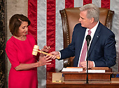 United States House Minority Leader Kevin McCarthy (Republican of California), right, hands the gavel to Speaker of the United States House of Representatives Nancy Pelosi (Democrat of California), left, as the 116th Congress convenes for its opening session in theUS House Chamber of the US Capitol in Washington, DC on Thursday, January 3, 2019.<br /> Credit: Ron Sachs / CNP<br /> (RESTRICTION: NO New York or New Jersey Newspapers or newspapers within a 75 mile radius of New York City)