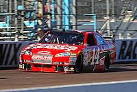 Apr 17, 2009; Avondale, AZ, USA; NASCAR Sprint Cup Series driver Tony Stewart during qualifying for the Subway Fresh Fit 500 at Phoenix International Raceway. Mandatory Credit: Mark J. Rebilas-