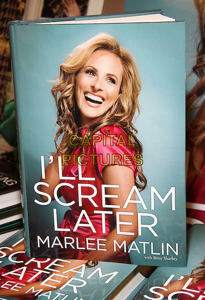 "MARLEE MATLIN's book.""I'll Scream Later"" Book Signing held at Bookends Book Store, Ridgewood, New Jersey, USA, .14th April 2009..book cover atmosphere .CAP/ADM/PZ.©Paul Zimmerman/Admedia/Capital Pictures"