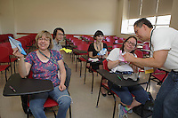 OrigamiUSA 2016 Convention at St. John's University, Queens, New York, USA. First timer, Tan Le, Minnesota, teaches a class of students Kawasaki Rose with Calyx. Back row, Alex Chen (l), Heather Willensky (r). Front row, Kathy Singer (l) and Julia Turner (r).