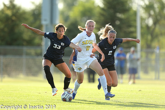 BROOKINGS, SD - AUGUST 23: Sunniva Dunagan #10 from South Dakota State University battles for the ball with Christian Sundstrom #33 and Paige Moser #2 from Utah State during their match Friday evening at Fischback Soccer field in Brookings. (Photo by Dave Eggen/Inertia)