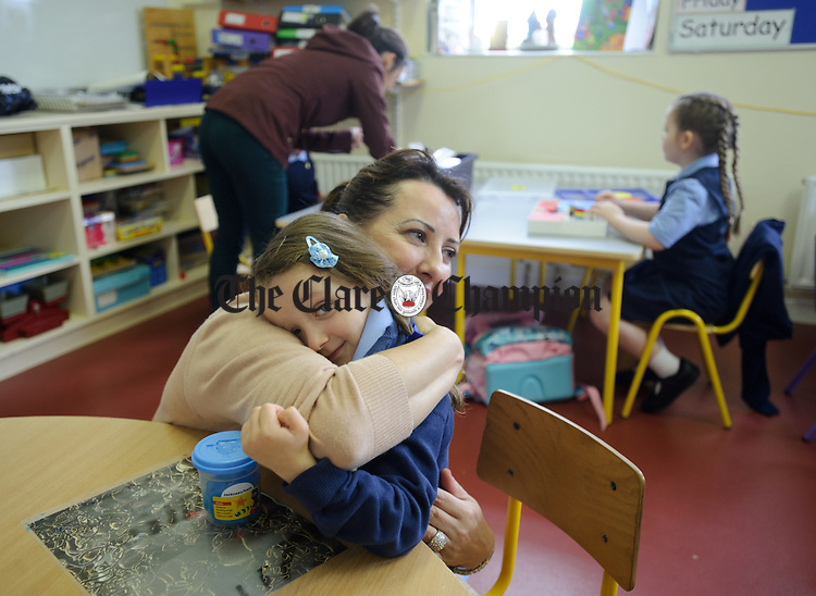Jennifer Rooney kisses her daughter Iris goodbye on her first day of school at Boston NS. Photograph by John Kelly.