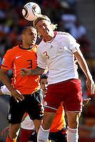 Welsey Sneijder of Holland (L) and Simon Kjaer of Denmark (R),