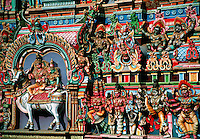 Detail of colorfully decorated gopuram Religious Tower Shree Meenakshi Hindu Temple Madurai India