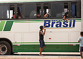 The Karaja indigenous delegation arrives by bus to take part in the first ever International Indigenous Games, in the city of Palmas, Tocantins State, Brazil. The games will start with an opening ceremony on Friday the 23rd October. Photo © Sue Cunningham, pictures@scphotographic.com 21st October 2015