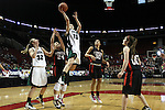 03/10/11--Tigard's Kelsey Kaelin flies to the basket past Oregon City defenders in the   quarterfinals of girls 6A championship at the Rose Garden in Portland, Or. The Pioneers advanced to the semifinals with a score of 66-36...Photo by Jaime Valdez........................................