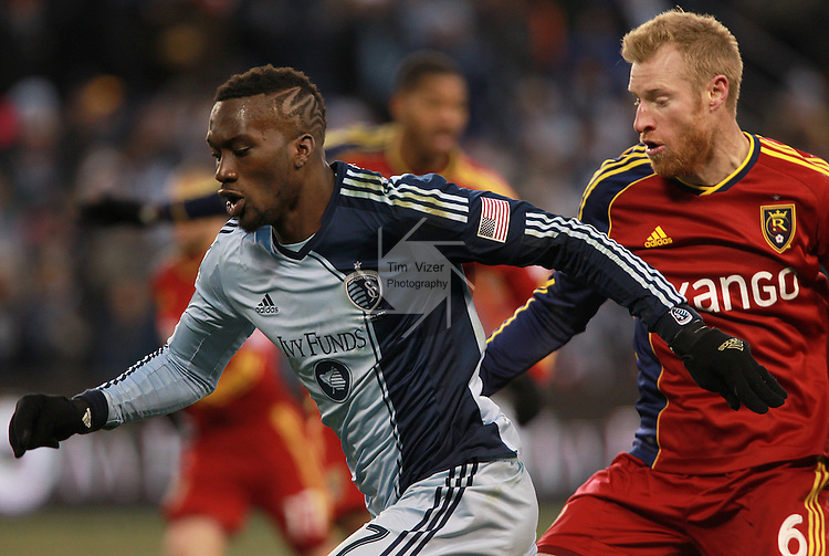 Sporting KC forward C.J. Sapong (17, left) and Real Salt Lake defender Nat Borchers (6) fight for possession in the second half. Sporting KC defeated Real Salt Lake in a shootout after the score was tied 1-1 at the end of regulation play in the MLS Cup 2013 championship held at Sporting Park in Kansas City, Kansas on Saturday December 7, 2013.