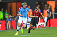 Kevin De Bruyne of Manchester City and Ryan Fraser of AFC Bournemouth compete for the ball during AFC Bournemouth vs Manchester City, Premier League Football at the Vitality Stadium on 25th August 2019