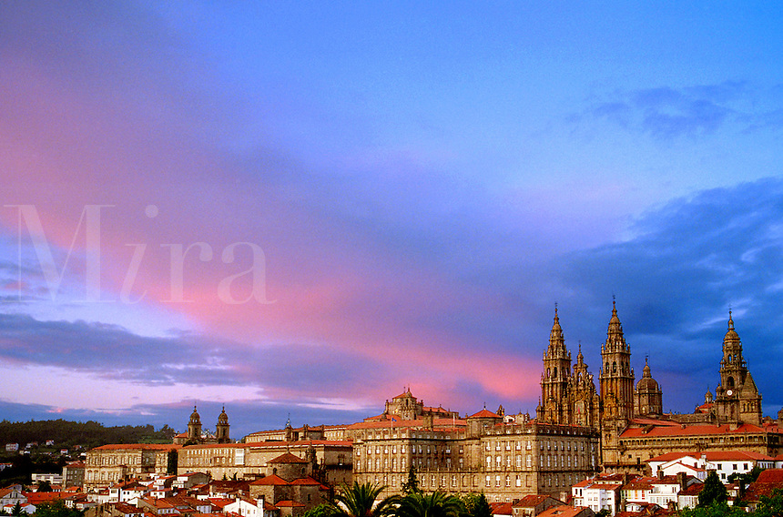 Spain, Galicia, Santiago de Compostela. Cathedral of the Apostle and the casco antiguo (old town), view from the park Carballeiria de Santa Susana. Rainbow.