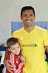 "All My Children's Mark Consuelos poses with son Joaquin as Mark participates at the ""Kicking It"" at the Annual Tribeca/NYFEST Soccer Day Celebrity Exhibition on April 21, 2012 - NYFEST (which stands for New York Film and Entertainment Soccer Tournament) was designed to mesh the worlds of entertainment, soccer and New York City in conjunction with the Tribeca Film Festival. The day included a film and entertainment industry tournament with 44 teams with one winner the Grassrootsoccer team which Mark Consuelos played on which was cofounded by Survivor Africa winner Ethan Zohn. The all-day event took place at Pier 40 in Manhattan, and consisted of an industry tournament, a youth showcase, and a celebrity soccer tournament.  (Photo by Sue Coflin/Max Photos)"
