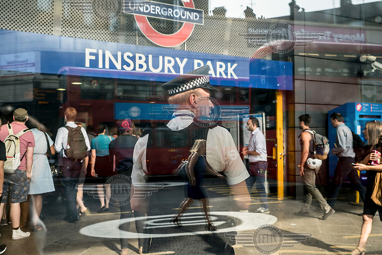 A policeman on patrol outside Finsbury Park station.